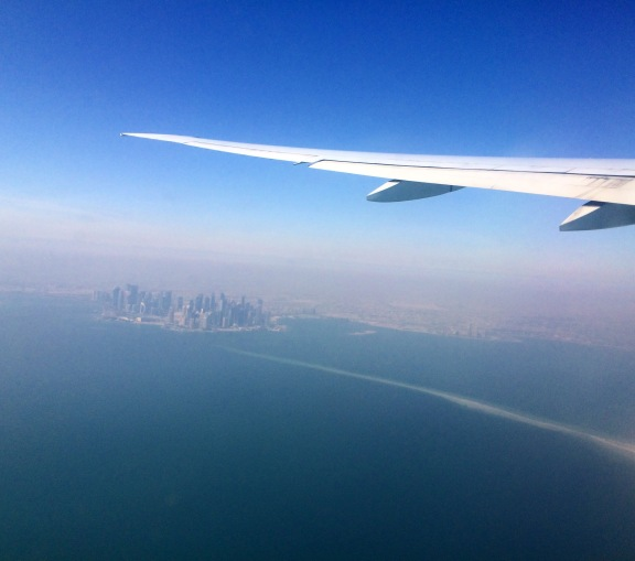 landing into doha airport with an amazing view of the city