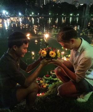 praying before floating a krathong in Lumphini Park